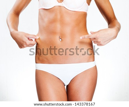 Slim tanned woman's body