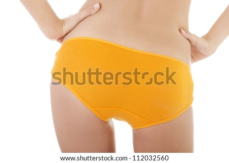 Slim tanned woman's body in orange panties. Isolated over white background.