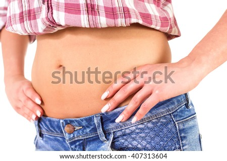 Slim waist of caucasian female in jeans and shirt.