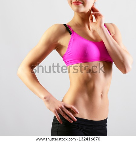 slim waist of young sporty woman, detail of perfect fit female body - stock photo
