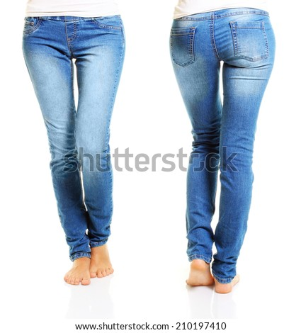 Slim woman body in blue jeans isolated on white background. - stock photo