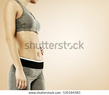 slim woman body on brown background