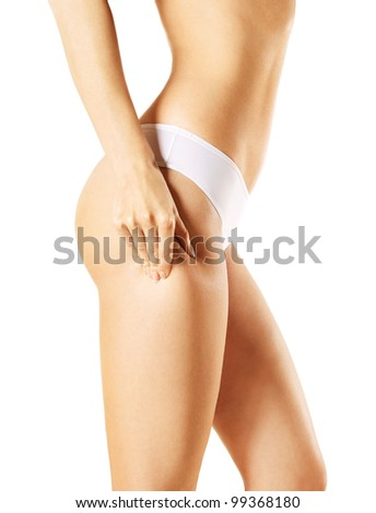 Slim woman body over isolated white background - stock photo