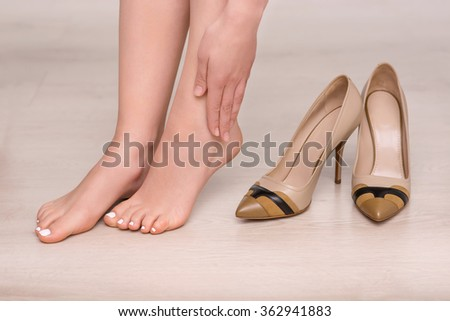Slim woman going to wear shoes