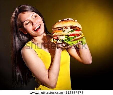 Slim woman holding hamburger. - stock photo