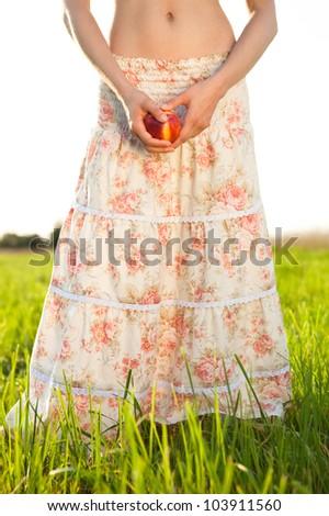 slim woman in long skirt - stock photo