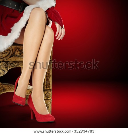 slim woman legs and chair