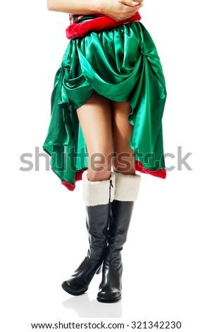Slim woman legs wearing elf boots. - stock photo