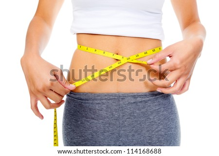 Slim woman measuring her weightloss with tape and looking at her waist. dieting concept. isolated on white - stock photo