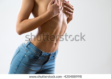 Slim woman shows her beautiful belly - stock photo