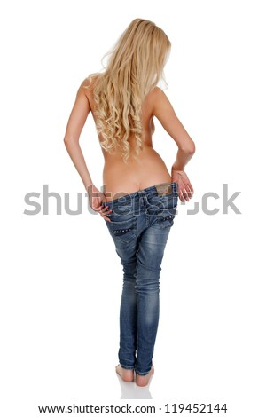 Slim woman taking off jeans, isolated on white - stock photo