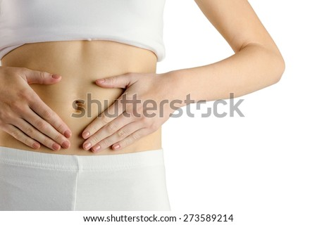 Slim woman touching her belly on white background - stock photo