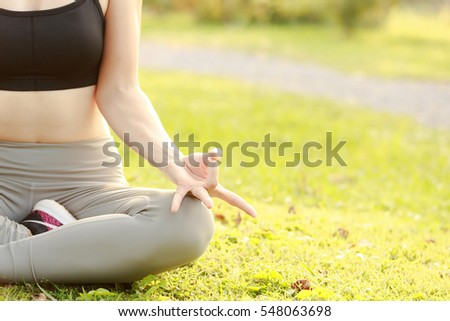 Slim women doing yoga in the park.