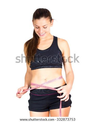 Slim Young Woman with perfect healthy fitness body, measuring her thin waist with a tape measure. Caucasian female in sportswear, over white background.Diet and weight loss concept.
