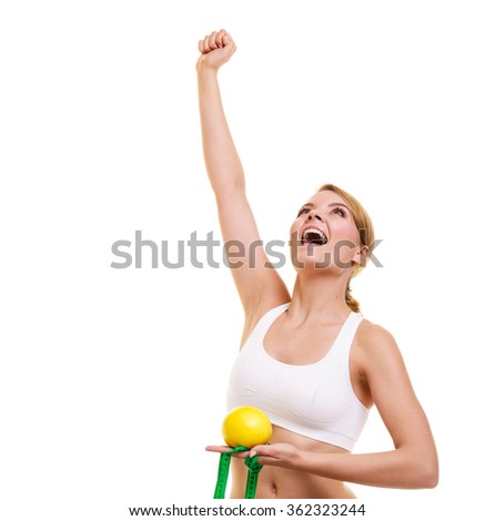Slimming diet weight loss. Happy joyful successful young woman girl with measuring tape on weighing scale holding grapefruit raising her hand. Healthy lifestyle concept. Isolated on white background. - stock photo