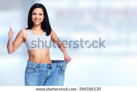 Slimming woman wearing big pants. - stock photo