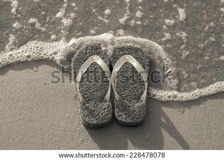Slipper on the beach in black and white style - stock photo