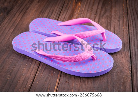 Slipper on wooden background - vintage effect style pictures