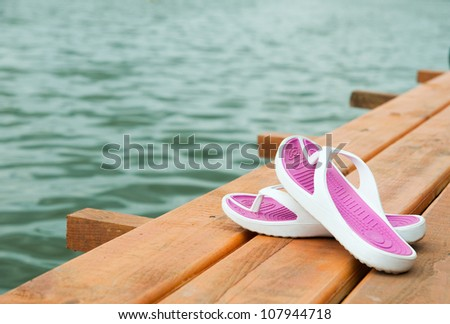 slippers on a wooden pier - stock photo