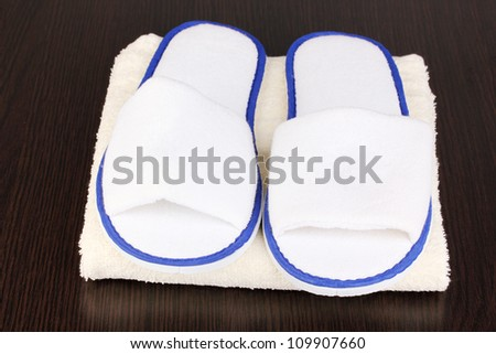 slippers on wooden background