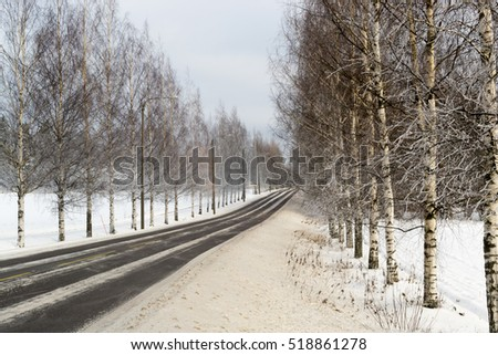 Slippery and icy road in countryside in winter