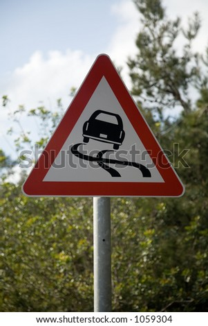 Slippery surface road sign - stock photo