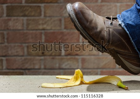 Slipping on a banana skin - stock photo