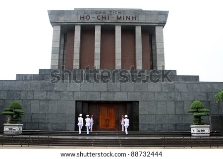 Slodiers in white uniform near Ho Chi Minh mausoleum in Hanoi, Vietnam - stock photo