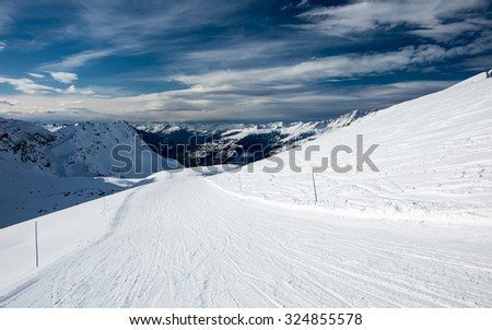 Slope for downhill skiing at Courmayeur ski resort in Italian Alps in sunny winter day - stock photo