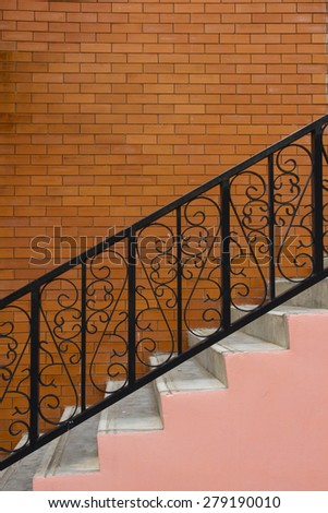 Sloping concrete stair steps and steel handrail - stock photo