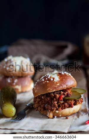 Sloppy joe burgers with pretzel buns