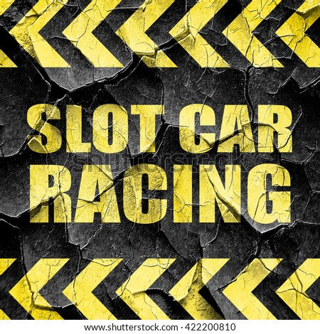 slot car racing, black and yellow rough hazard stripes - stock photo