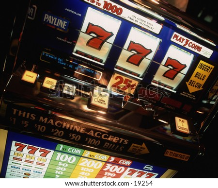 Slot machine with winning 777. - stock photo