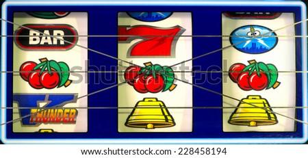 Slot machine with winning cherry jackpot. - stock photo