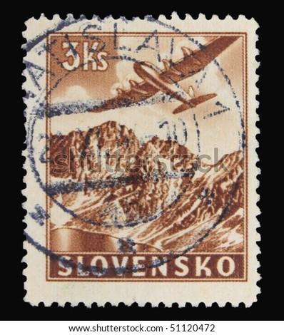 SLOVAKIA - CIRCA 1943: A stamp printed in Slovakia showing airplane circa 1943 - stock photo