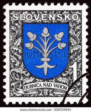SLOVAKIA - CIRCA 1993: A stamp printed in Slovakia shows Arms of Dubnica nad Vahom, circa 1993.  - stock photo