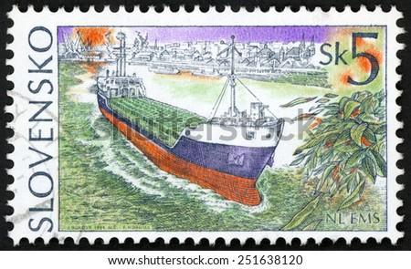 SLOVAKIA - CIRCA 1994: post stamp printed in Slovensko shows merchant cargo ship NL EMS leaving harbor; Scott 201 A85 5sk green blue red, circa 1994 - stock photo