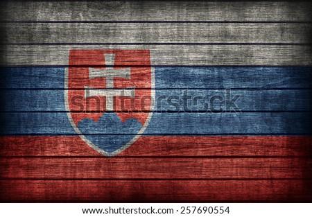 Slovakia flag pattern on wooden board texture ,retro vintage style - stock photo