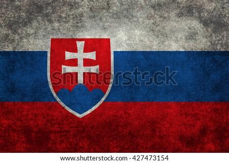 Slovakian national flag with a vintage textured treatment - stock photo