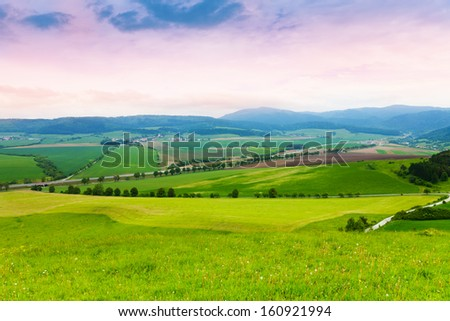Slovakian wheat fields hills, road and mountains - stock photo