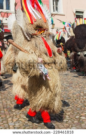 Slovene old traditional carnival mask, chasing away winter, calling spring, running and dancing on the streets of Ptuj, Slovenia - stock photo