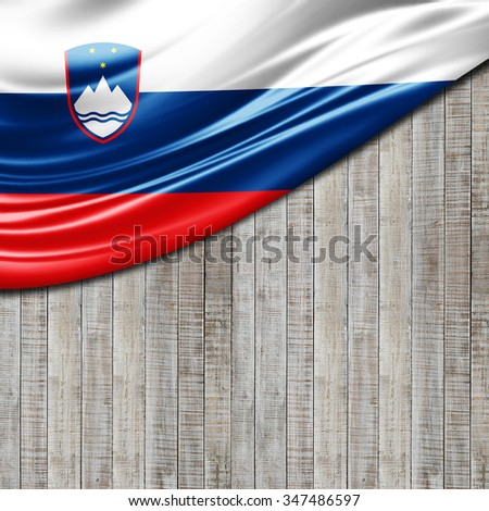 Slovenia flag of silk with copyspace for your text or images and wood background