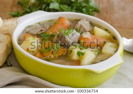 Slow-cooked Irish stew with tender lamb meat, potatoes and vegetables - stock photo