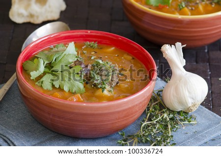 Slow-cooked lamb with root vegetable soup in a bowl - stock photo
