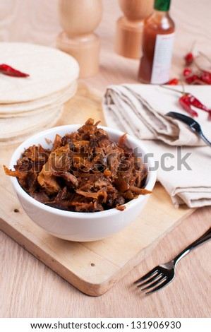 Slow cooked pulled meat pork and tortillas pitas with spices