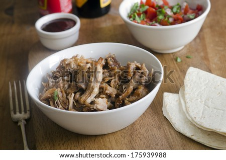 Slow cooker chipotle pulled pork with salsa - stock photo