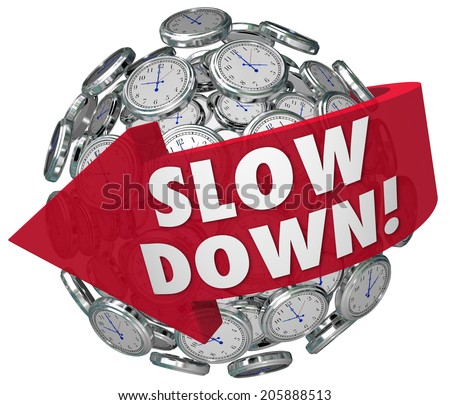 Slow Down words on a ball or sphere of clocks warning you to go slower to avoid danger