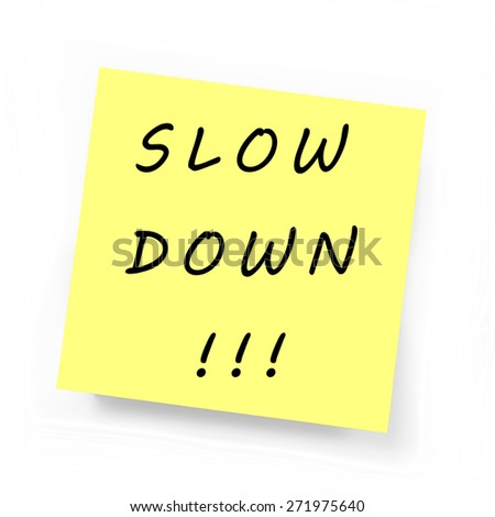 SLOW DOWN - Yellow Sticky Note on white background