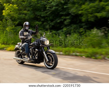 slow motion, biker riding unknown motorbike with blur movement, speed concept - stock photo