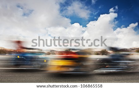 Slow motion on motorbikes, blur movement on bike riders, motorcycle road trip, summer US tour ride, people traveling on countryside highway, freedom lifestyle - stock photo